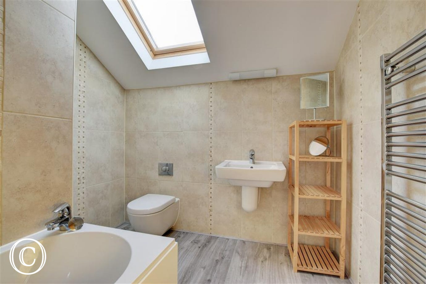 Family bathroom with shower over bath, wc & basin