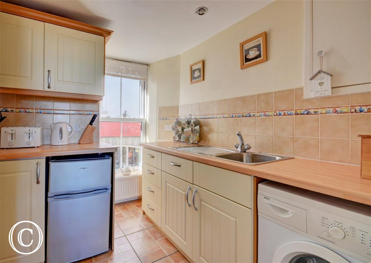 Small kitchen area equipped for self catering holidays