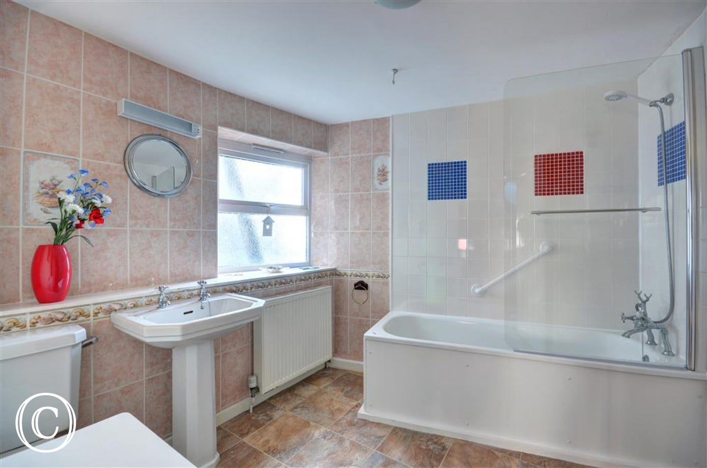 Family bathroom with shower over the bath, wc & basin