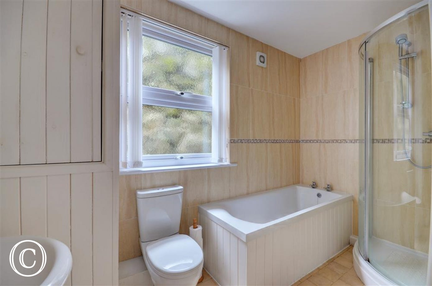 Bathroom with bath & seperate shower cubicle
